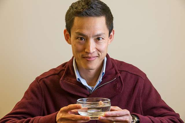 Assistant Professor Voot P. Yin with his zebrafish. The study of the latter has led to invaluable discoveries that are expected to help harness the power of dormant genes in humans to restore heart tissues damaged by heart attacks. Photo credits: MDI Biological Laboratory.