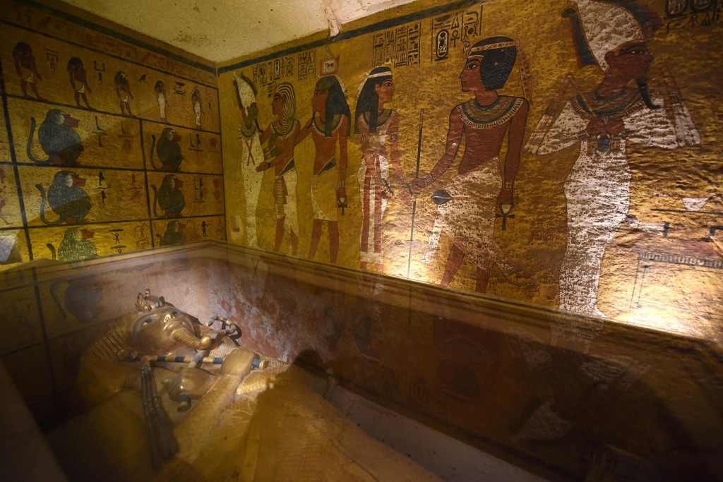 The walls of King Tutankhamun's burial chamber are painted with scenes depicting the burial rituals of the young pharaoh. Radar scans suggest the presence of open spaces behind the walls. PHOTOGRAPH BY BRANDO QUILICCI, NATIONAL GEOGRAPHIC