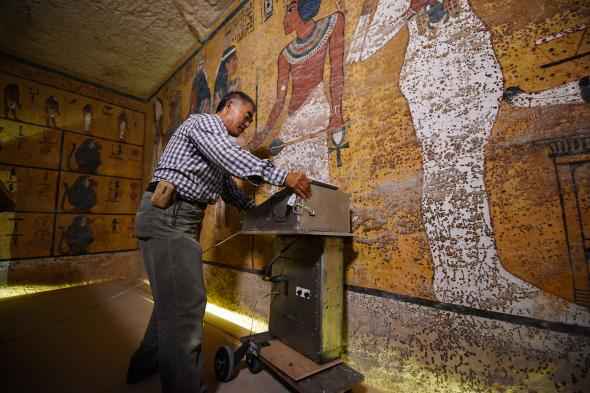 Hirokatsu Watanabe, a radar specialist from Japan, pushes his specially modified Koden-brand machine along the north wall of Tutankhamun's burial chamber during radar scanning last fall. PHOTOGRAPH BY BRANDO QUILICCI, NATIONAL GEOGRAPHIC