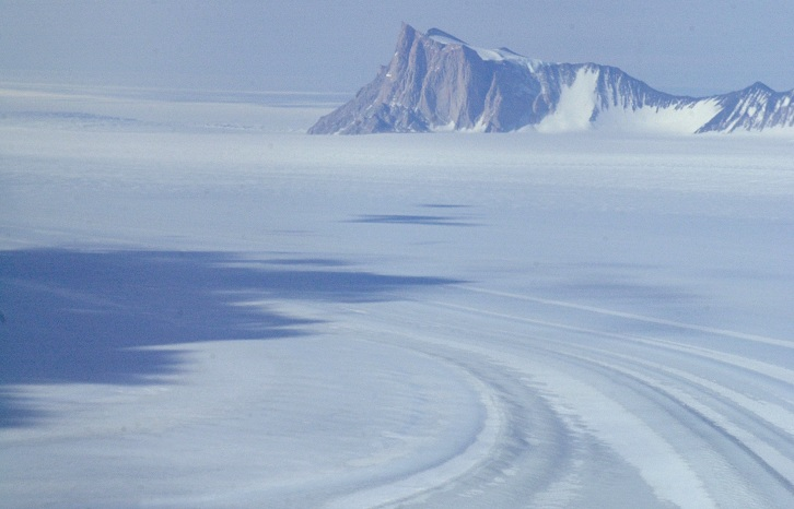 The Beardmore Glacier was Robert Scott's route to the South Pole. During that trip he discovered the rich fossil record hidden in the outcrops of rock. Since then paleontologists have come to the Beardmore Glacier to collect fossils, as they were doing when this December 2003 photo was taken.